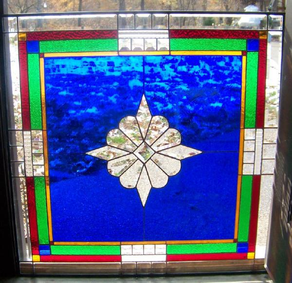 blue stained glass repaired window
