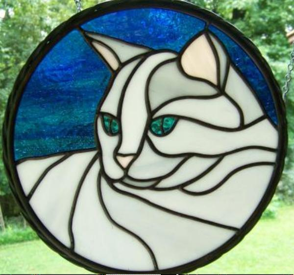twisted stained glass frame cat blue eyes